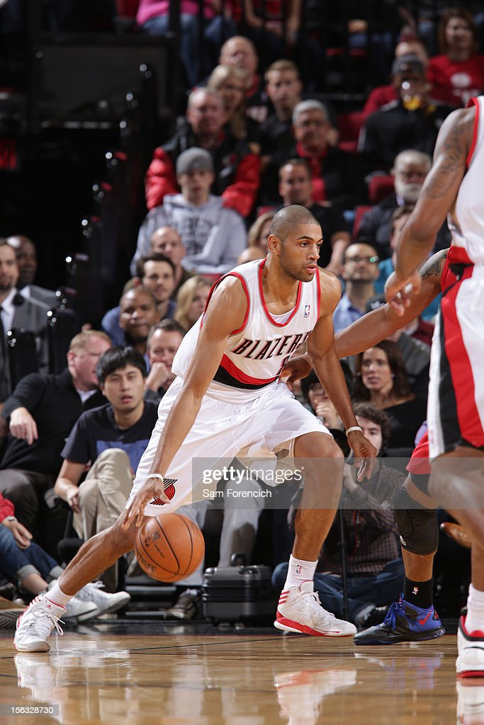 <a gi-track='captionPersonalityLinkClicked' href=/galleries/search?phrase=Nicolas+Batum&family=editorial&specificpeople=3746275 ng-click='$event.stopPropagation()'>Nicolas Batum</a> #88 of the Portland Trail Blazers handles the ball against the Los Angeles Clippers on November 8, 2012 at the Rose Garden Arena in Portland, Oregon.