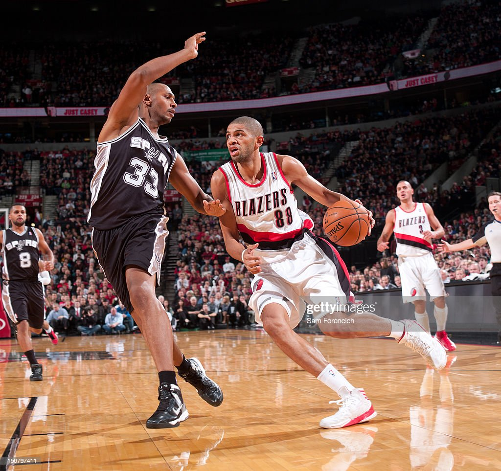 <a gi-track='captionPersonalityLinkClicked' href=/galleries/search?phrase=Nicolas+Batum&family=editorial&specificpeople=3746275 ng-click='$event.stopPropagation()'>Nicolas Batum</a> #88 of the Portland Trail Blazers handles the ball against <a gi-track='captionPersonalityLinkClicked' href=/galleries/search?phrase=Boris+Diaw&family=editorial&specificpeople=201505 ng-click='$event.stopPropagation()'>Boris Diaw</a> #33 of the San Antonio Spurs on November 10, 2012 at the Rose Garden Arena in Portland, Oregon.