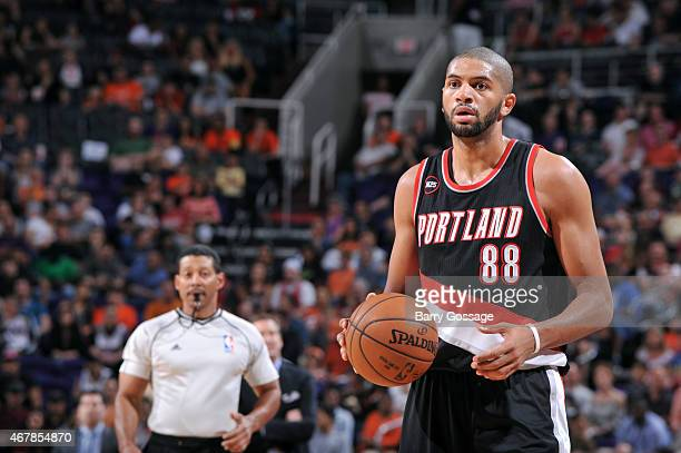 Nicolas Batum of the Portland Trail Blazers handles the ball against the Phoenix Suns on March 27 2015 at US Airways Center in Phoenix Arizona NOTE...