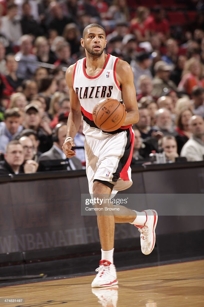 Nicolas Batum #88 of the Portland Trail Blazers handles the ball during a game against the Minnesota Timberwolves on February 23, 2014 at the Moda Center Arena in Portland, Oregon.