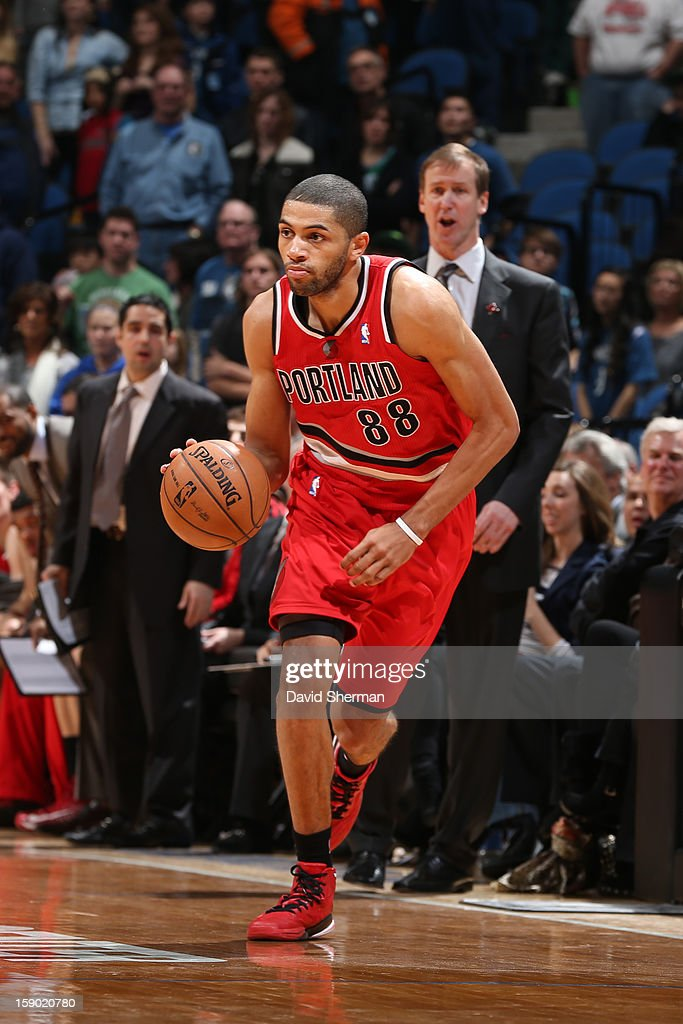 <a gi-track='captionPersonalityLinkClicked' href=/galleries/search?phrase=Nicolas+Batum&family=editorial&specificpeople=3746275 ng-click='$event.stopPropagation()'>Nicolas Batum</a> #88 of the Portland Trail Blazers handles the ball up-court against the Minnesota Timberwolves during the game on January 5, 2013 at Target Center in Minneapolis, Minnesota.