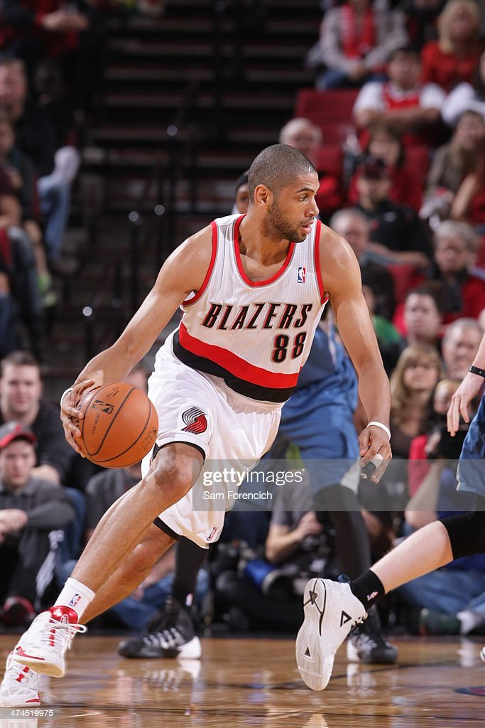 Nicolas Batum #88 of the Portland Trail Blazers handling the ball during a game against the Minnesota Timberwolves on February 23, 2014 at the Moda Center Arena in Portland, Oregon.