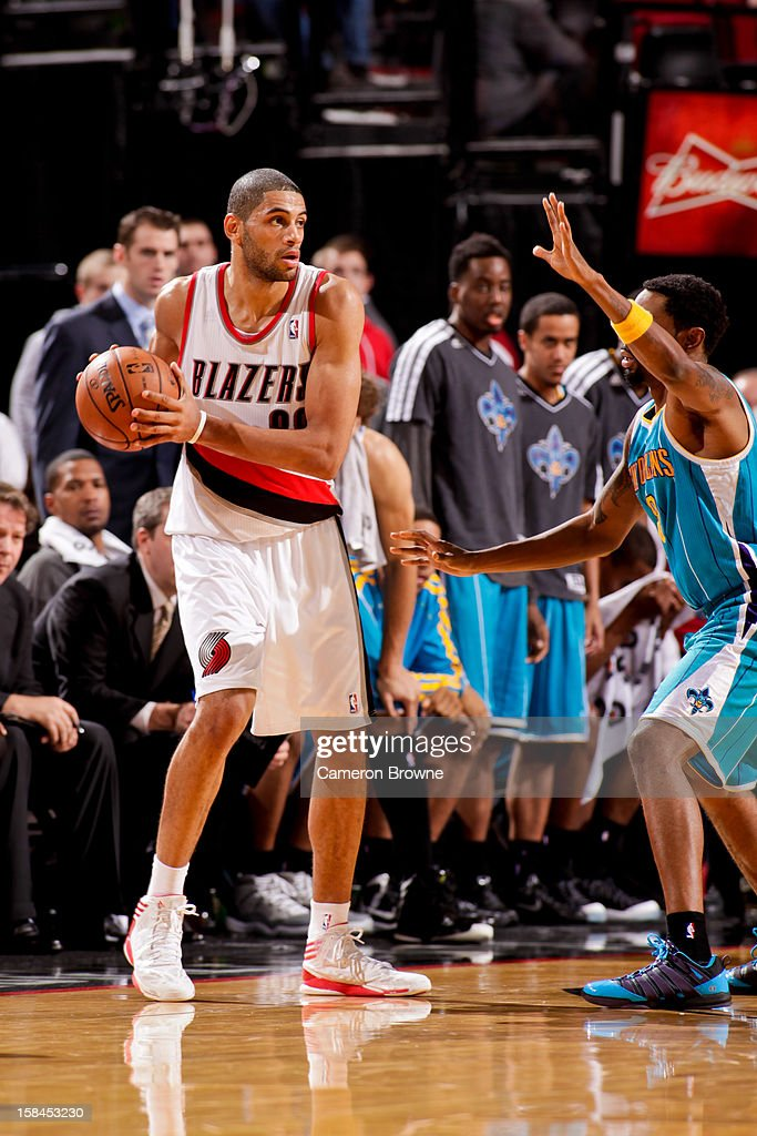 <a gi-track='captionPersonalityLinkClicked' href=/galleries/search?phrase=Nicolas+Batum&family=editorial&specificpeople=3746275 ng-click='$event.stopPropagation()'>Nicolas Batum</a> #88 of the Portland Trail Blazers looks to pass the ball against the New Orleans Hornets on December 16, 2012 at the Rose Garden Arena in Portland, Oregon.