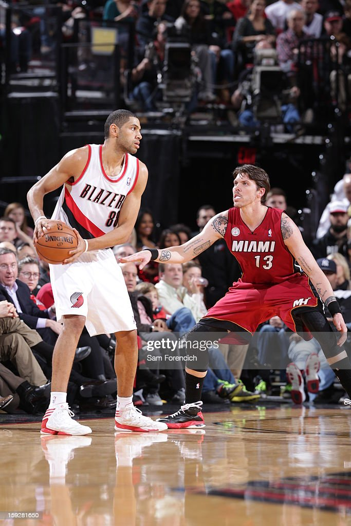 Nicolas Batum #88 of the Portland Trail Blazers looks to pass the ball against Mike Miller #13 of the Miami Heat on January 10, 2013 at the Rose Garden Arena in Portland, Oregon.