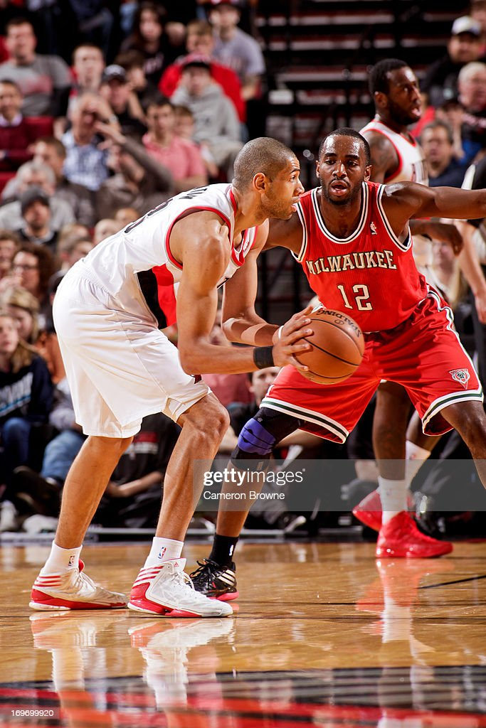 <a gi-track='captionPersonalityLinkClicked' href=/galleries/search?phrase=Nicolas+Batum&family=editorial&specificpeople=3746275 ng-click='$event.stopPropagation()'>Nicolas Batum</a> #88 of the Portland Trail Blazers looks to pass the ball against <a gi-track='captionPersonalityLinkClicked' href=/galleries/search?phrase=Luc+Richard+Mbah+a+Moute&family=editorial&specificpeople=699041 ng-click='$event.stopPropagation()'>Luc Richard Mbah a Moute</a> #12 of the Milwaukee Bucks on January 19, 2013 at the Rose Garden Arena in Portland, Oregon.