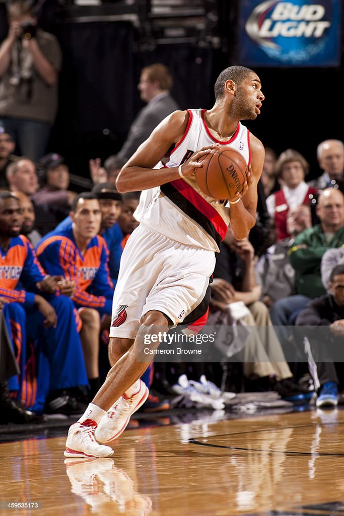 <a gi-track='captionPersonalityLinkClicked' href=/galleries/search?phrase=Nicolas+Batum&family=editorial&specificpeople=3746275 ng-click='$event.stopPropagation()'>Nicolas Batum</a> #88 of the Portland Trail Blazers looks to pass the ball against the New York Knicks on November 25, 2013 at the Moda Center Arena in Portland, Oregon.