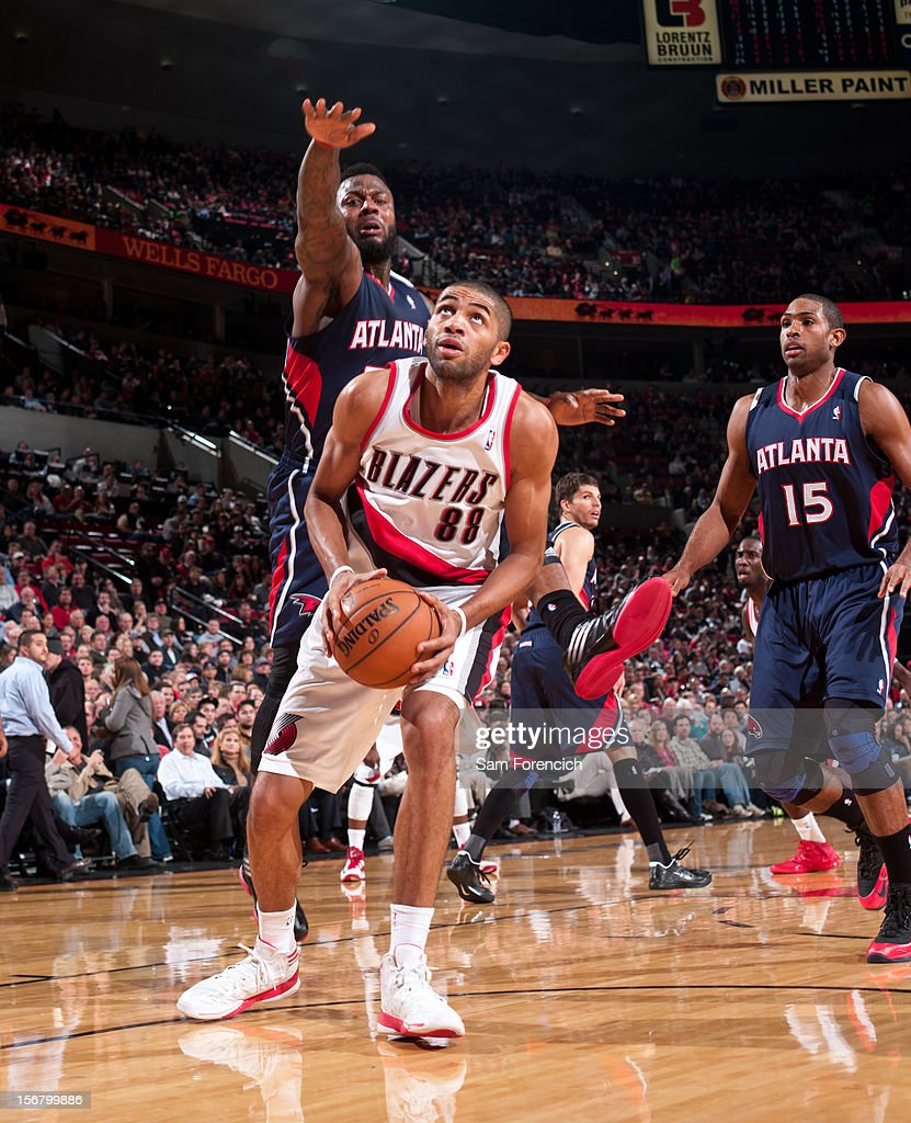 <a gi-track='captionPersonalityLinkClicked' href=/galleries/search?phrase=Nicolas+Batum&family=editorial&specificpeople=3746275 ng-click='$event.stopPropagation()'>Nicolas Batum</a> #88 of the Portland Trail Blazers looks to shoot the ball against <a gi-track='captionPersonalityLinkClicked' href=/galleries/search?phrase=DeShawn+Stevenson&family=editorial&specificpeople=202494 ng-click='$event.stopPropagation()'>DeShawn Stevenson</a> #92 of the Atlanta Hawks on November 12, 2012 at the Rose Garden Arena in Portland, Oregon.