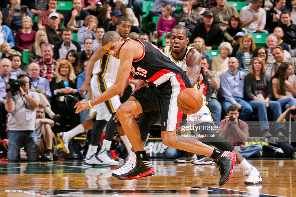Nicolas Batum #88 of the Portland Trail Blazers loses control of the ball against Paul Millsap #24 of the Utah Jazz at Energy Solutions Arena on April 1, 2013 in Salt Lake City, Utah.