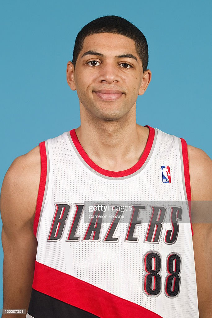 <a gi-track='captionPersonalityLinkClicked' href=/galleries/search?phrase=Nicolas+Batum&family=editorial&specificpeople=3746275 ng-click='$event.stopPropagation()'>Nicolas Batum</a> #88 of the Portland Trail Blazers poses for a portrait during Media Day on December 16, 2011 at the Rose Garden Arena in Portland, Oregon.