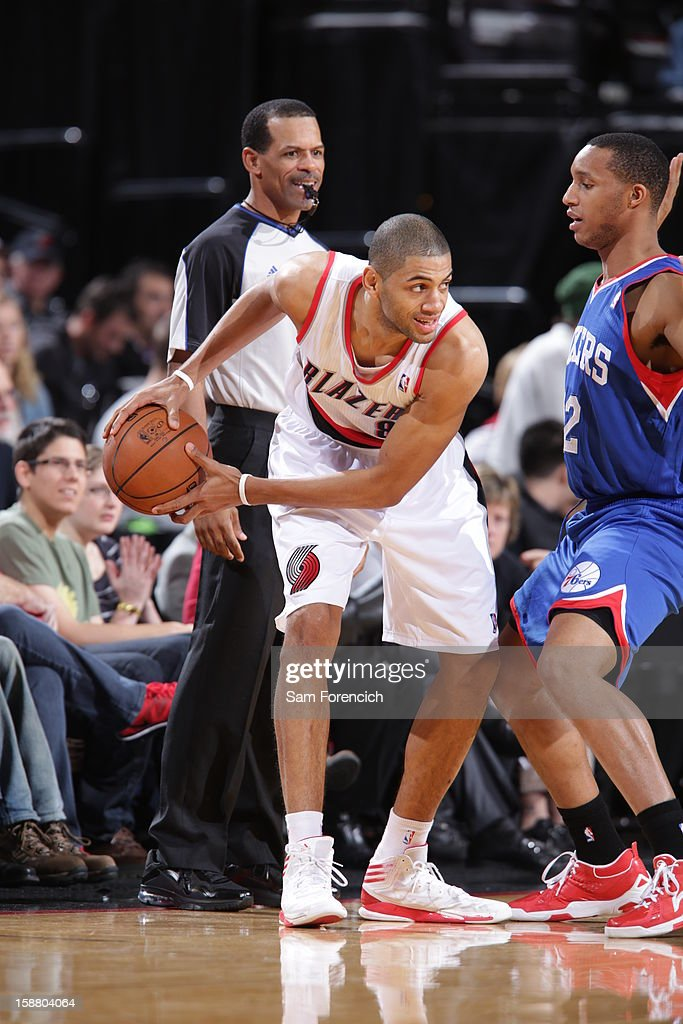 Nicolas Batum #88 of the Portland Trail Blazers protects the ball during the game between the Philadelphia 76ers and the Portland Trail Blazers on December 29, 2012 at the Rose Garden Arena in Portland, Oregon.