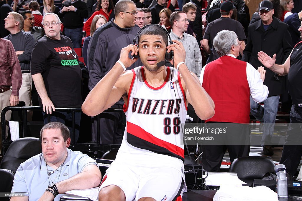 Nicolas Batum #88 of the Portland Trail Blazers puts on headphones for an interview after the game against the Miami Heat on January 10, 2013 at the Rose Garden Arena in Portland, Oregon.