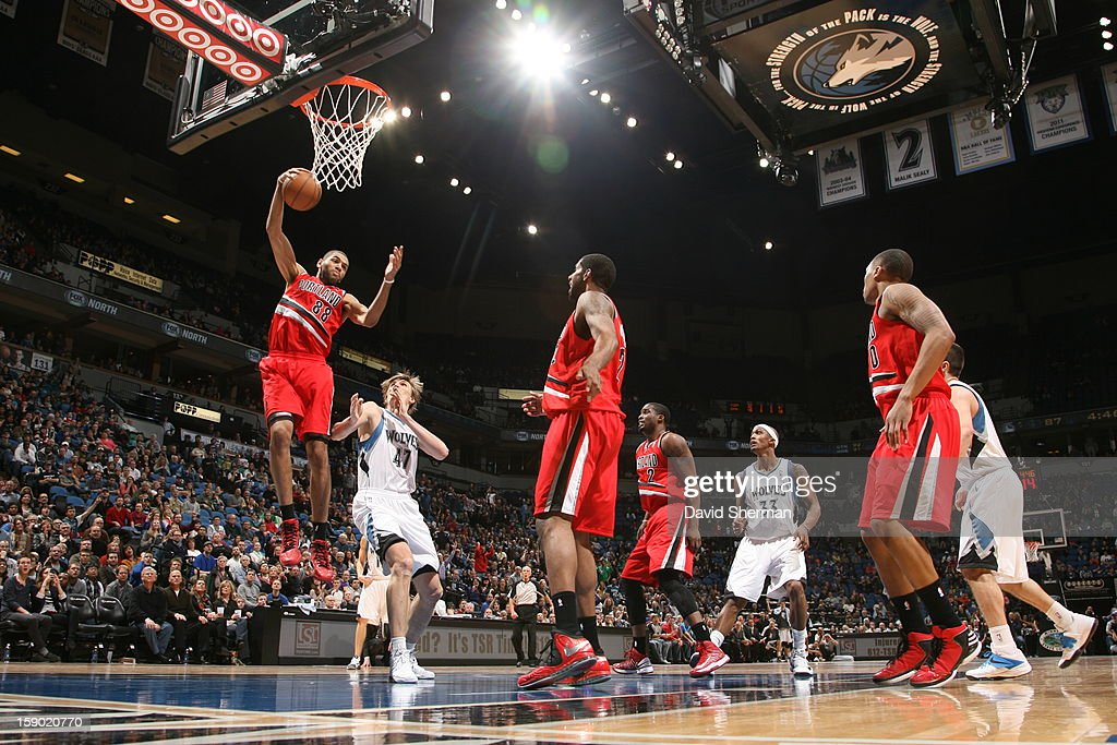<a gi-track='captionPersonalityLinkClicked' href=/galleries/search?phrase=Nicolas+Batum&family=editorial&specificpeople=3746275 ng-click='$event.stopPropagation()'>Nicolas Batum</a> #88 of the Portland Trail Blazers rebounds against <a gi-track='captionPersonalityLinkClicked' href=/galleries/search?phrase=Andrei+Kirilenko&family=editorial&specificpeople=201909 ng-click='$event.stopPropagation()'>Andrei Kirilenko</a> #47 of the Minnesota Timberwolves during the game on January 5, 2013 at Target Center in Minneapolis, Minnesota.