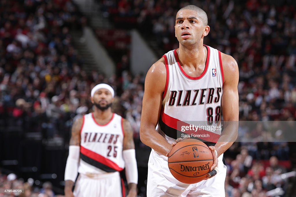 Nicolas Batum #88 of the Portland Trail Blazers shoots a foul shot against the Milwaukee Bucks on March 18, 2014 at the Moda Center Arena in Portland, Oregon.