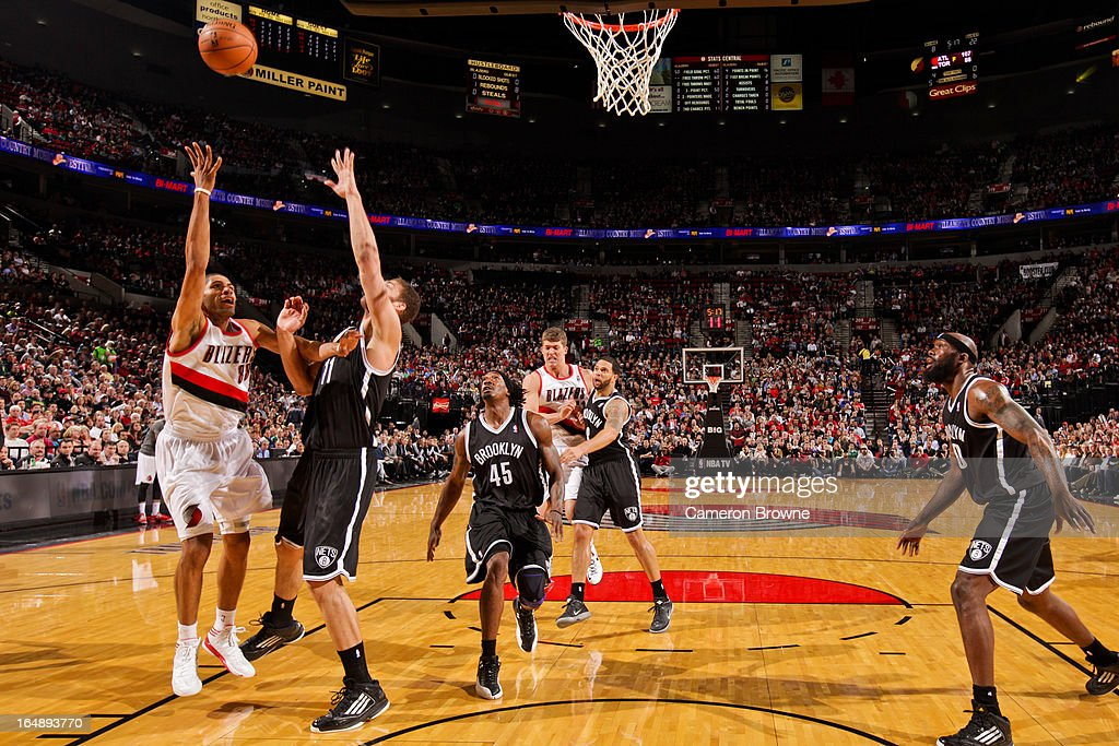 Nicolas Batum #88 of the Portland Trail Blazers shoots a layup against the Brooklyn Nets on March 27, 2013 at the Rose Garden Arena in Portland, Oregon.