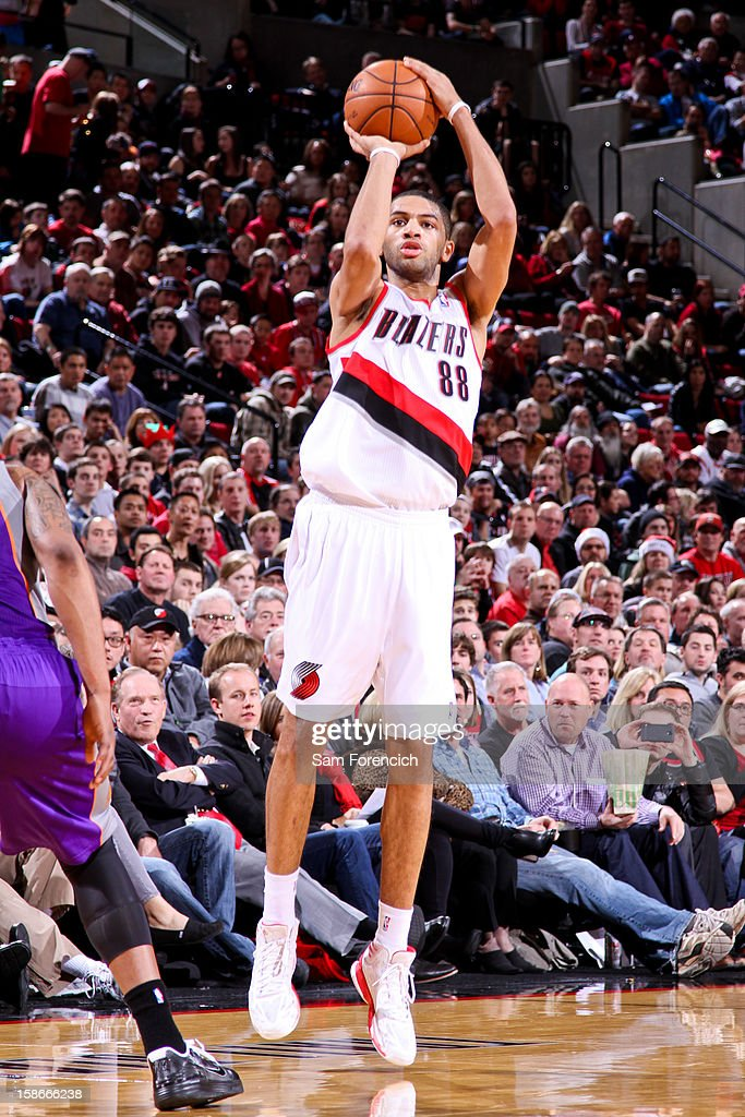 <a gi-track='captionPersonalityLinkClicked' href=/galleries/search?phrase=Nicolas+Batum&family=editorial&specificpeople=3746275 ng-click='$event.stopPropagation()'>Nicolas Batum</a> #88 of the Portland Trail Blazers shoots a three-pointer against the Phoenix Suns on December 22, 2012 at the Rose Garden Arena in Portland, Oregon.