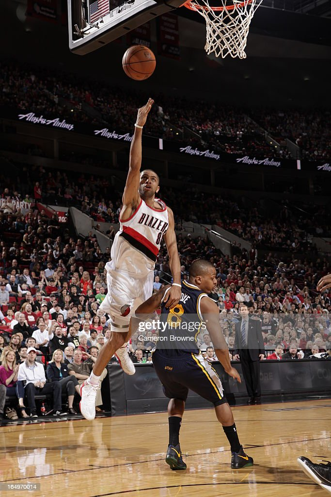<a gi-track='captionPersonalityLinkClicked' href=/galleries/search?phrase=Nicolas+Batum&family=editorial&specificpeople=3746275 ng-click='$event.stopPropagation()'>Nicolas Batum</a> #88 of the Portland Trail Blazers shoots against <a gi-track='captionPersonalityLinkClicked' href=/galleries/search?phrase=Randy+Foye&family=editorial&specificpeople=240185 ng-click='$event.stopPropagation()'>Randy Foye</a> #8 of the Utah Jazz on March 29, 2013 at the Rose Garden Arena in Portland, Oregon.