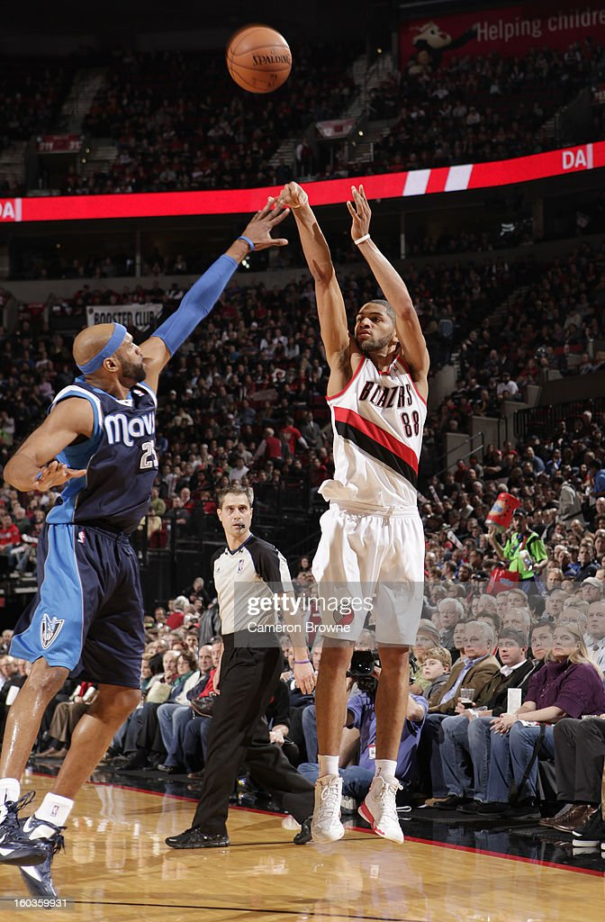 Nicolas Batum #88 of the Portland Trail Blazers shoots the ball against Vince Carter #25 of the Dallas Mavericks during the game between the Dallas Mavericks and the Portland Trail Blazers on January 29, 2013 at the Rose Garden Arena in Portland, Oregon.