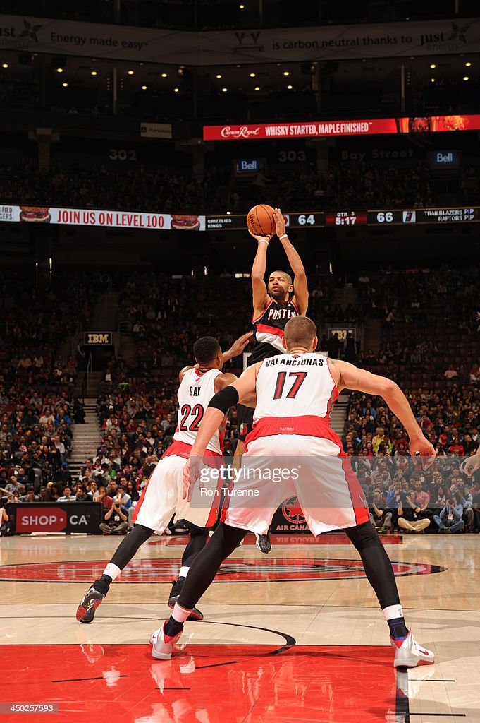 <a gi-track='captionPersonalityLinkClicked' href=/galleries/search?phrase=Nicolas+Batum&family=editorial&specificpeople=3746275 ng-click='$event.stopPropagation()'>Nicolas Batum</a> #88 of the Portland Trail Blazers shoots the ball against the Toronto Raptors during the game on November 17, 2013 at the Air Canada Centre in Toronto, Ontario, Canada.