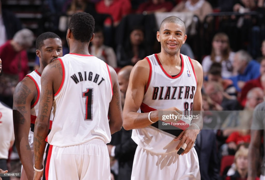 <a gi-track='captionPersonalityLinkClicked' href=/galleries/search?phrase=Nicolas+Batum&family=editorial&specificpeople=3746275 ng-click='$event.stopPropagation()'>Nicolas Batum</a> #88 of the Portland Trail Blazers smiles and walks off the court against the Milwaukee Bucks on March 18, 2014 at the Moda Center Arena in Portland, Oregon.