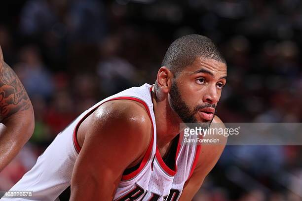 Nicolas Batum of the Portland Trail Blazers stands on the court during a game against the Phoenix Suns on March 30 2015 at the Moda Center Arena in...