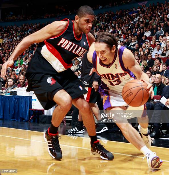 Nicolas Batum of the Portland Trail Blazers tries to stop Steve Nash of the Phoenix Suns as goes dribbles along the baseline during their preseason...