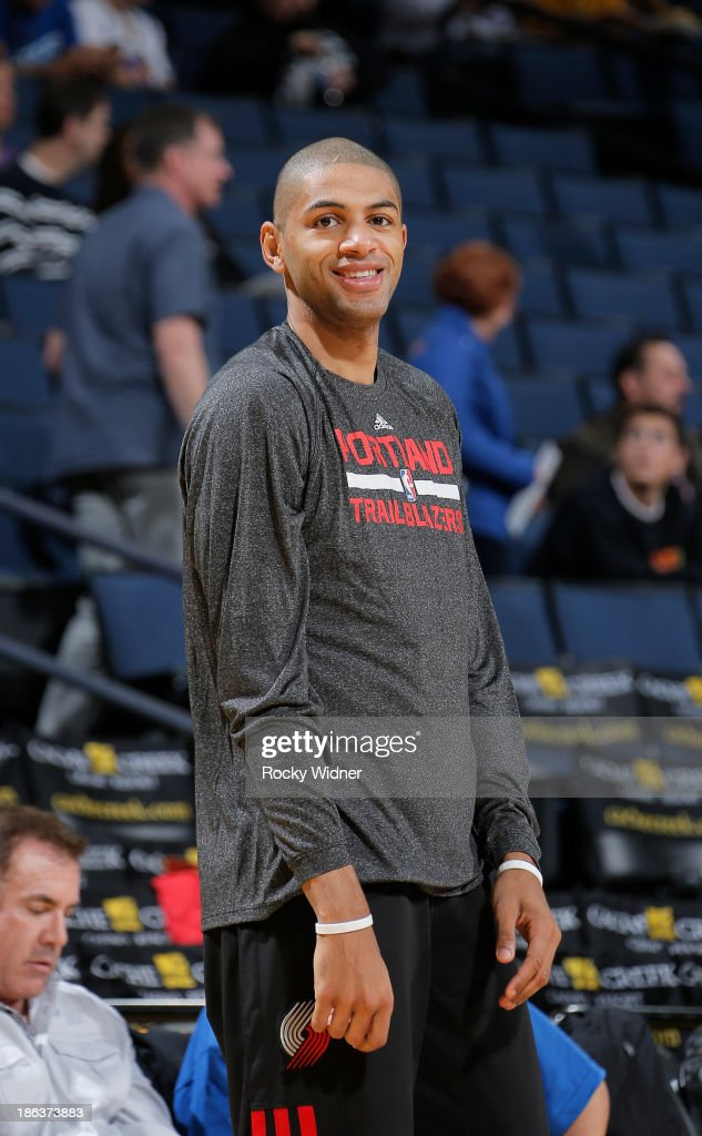 <a gi-track='captionPersonalityLinkClicked' href=/galleries/search?phrase=Nicolas+Batum&family=editorial&specificpeople=3746275 ng-click='$event.stopPropagation()'>Nicolas Batum</a> #88 of the Portland Trail Blazers warms up against the Golden State Warriors on October 24, 2013 at Oracle Arena in Oakland, California.