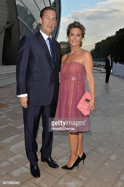 Nicolas Bazire and Fabienne Bazire attend the Foundation Louis Vuitton Opening at Foundation Louis Vuitton on October 20 2014 in BoulogneBillancourt...