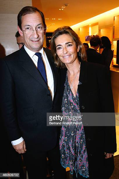 Nicolas Bazire and his wife Fabienne attend the Louis Vuitton Montaigne Store ReOpening party at Louis Vuitton Avenue Montaigne Store on December 15...
