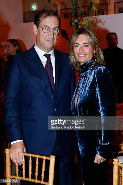 Nicolas Bazire and his wife Fabienne attend the Societe des Amis du Musee d'Art Moderne Dinner Party at the Musee d'Art Moderne on October 18 2016 in...