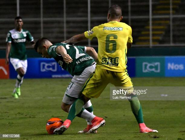 Nicolas Benedetti of Deportivo Cali vies for the ball with Mateus Uribe of Atletico Nacional during the Final first leg match between Deportivo Cali...