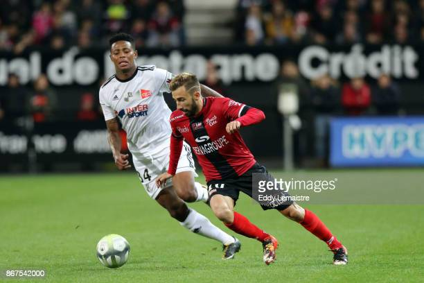 Nicolas Benezet of Guingamp and Bongani Zungu of Amiens during the Ligue 1 match between EA Guingamp and Amiens SC at Stade du Roudourou on October...
