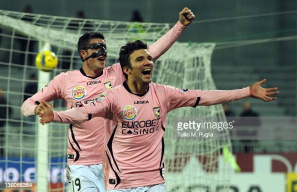 Nicolas Bertolo of Palermo celebrates with his teammate Igor Budan after scoring his team's second goal during the Serie A match between Novara...