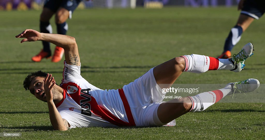 <a gi-track='captionPersonalityLinkClicked' href=/galleries/search?phrase=Nicolas+Bertolo&family=editorial&specificpeople=3937136 ng-click='$event.stopPropagation()'>Nicolas Bertolo</a>, of River Plate, falls down after being tackled during a match between River Plate and Velez Sarsfield as part of Torneo Transicion 2016 at Antonio Vespucio Liberti Stadium on April 30, 2016 in Buenos Aires, Argentina.