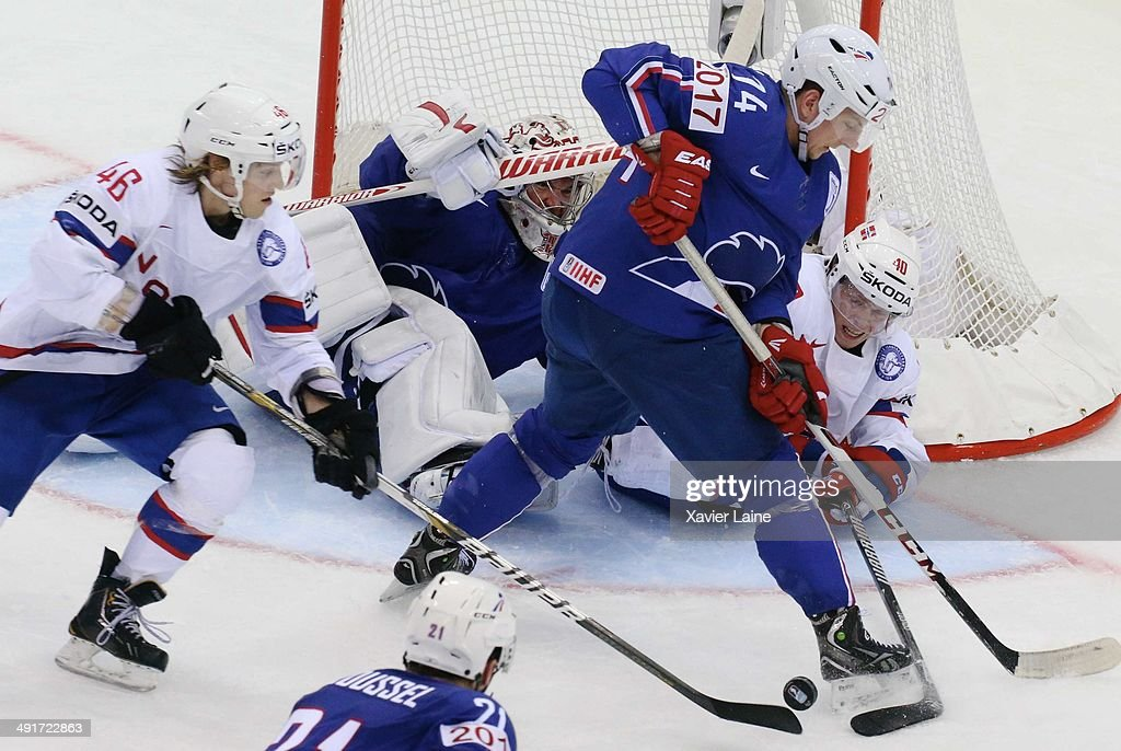 Nicolas Besch and Cristobal Huet of France battle for the puck with Mathis Olimb and Ken Andre Olimb of Norway during the 2014 IIHF World Championship between France and Norway at Chizhovka arena ,on may 17,2014 in Minsk, Belarus.