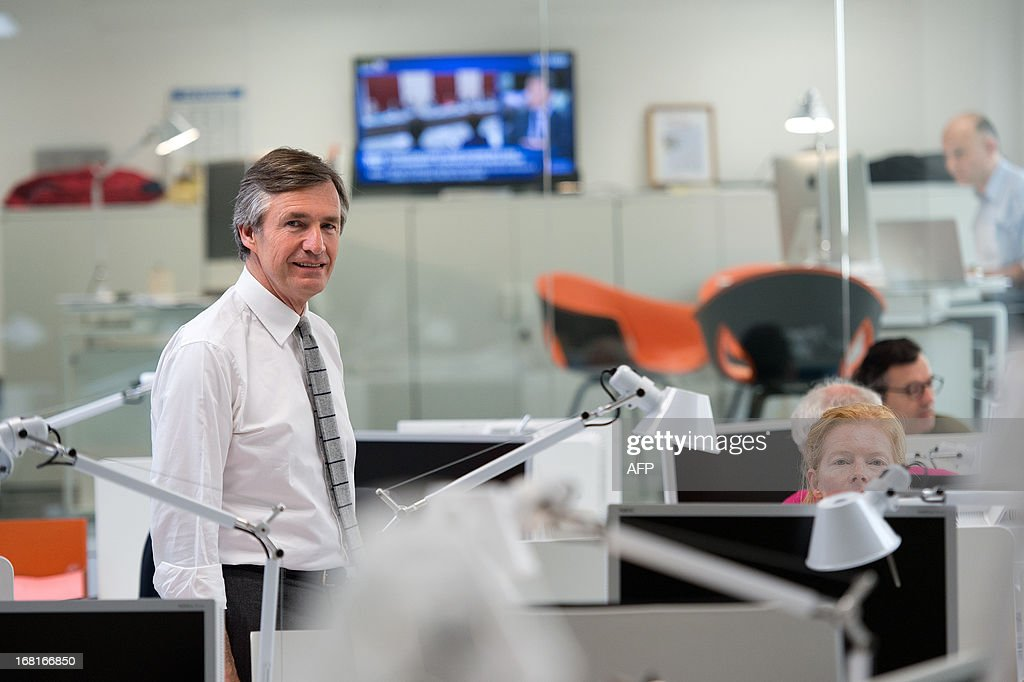 Nicolas Beytout (L), CEO and founder of new French media company 'L'Opinion', which aims to be a daily online newspaper also sold in print form five days a week, as well as an online news app and a webtv, poses for a photograph inside the newspaper's offices in Paris, on May 6, 2013. The launch of the new newspaper will be on May 14, according to the CEO.