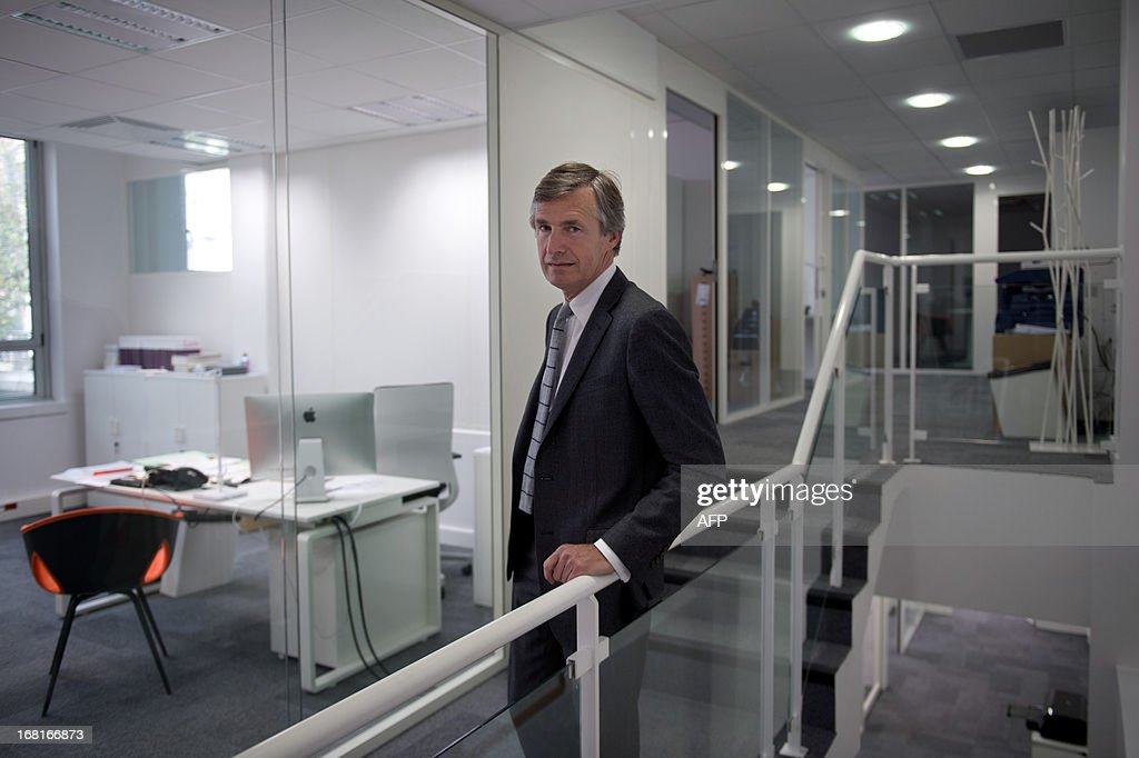 Nicolas Beytout (L), CEO and founder of new French media company 'L'Opinion', which aims to be a daily online newspaper also sold in print form five days a week, as well as an online news app and a webtv, poses for a photograph inside the newspaper's offices in Paris, on May 6, 2013. The launch of the new newspaper will be on May 14, according to the CEO. AFP PHOTO / LIONEL BONAVENTURE