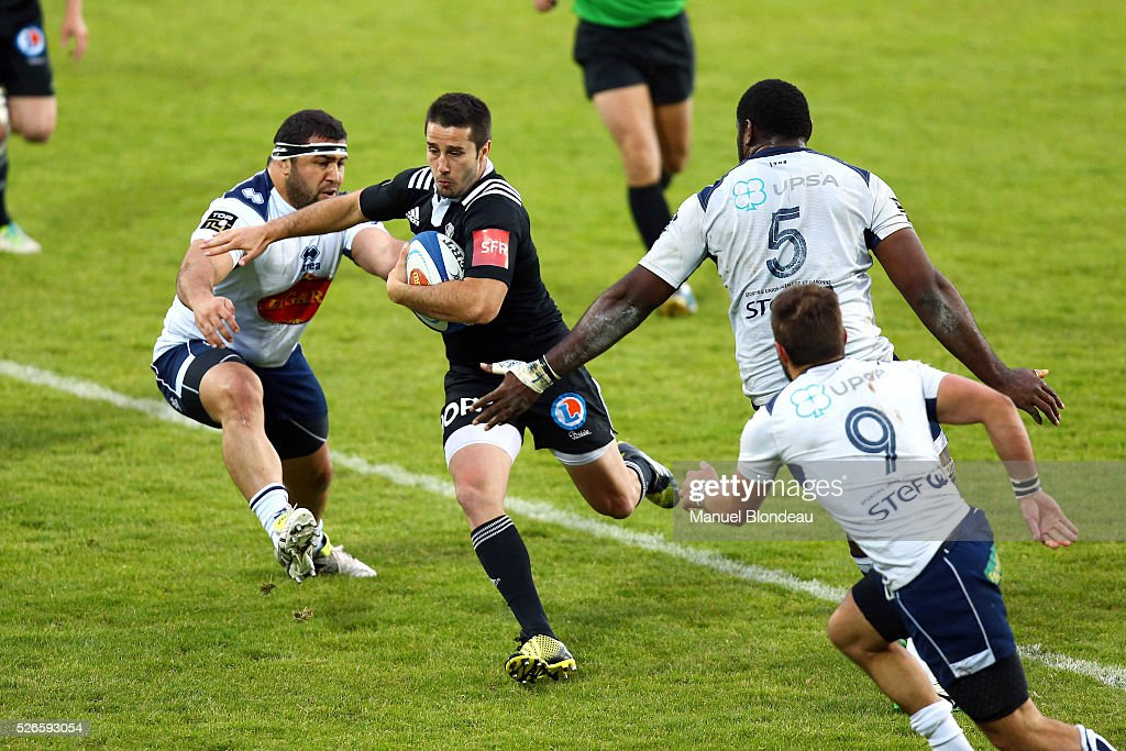 Nicolas Bezy of Brive evades Giorgi Tetrashvili of Agen during the French Top 14 rugby union match between SU Agen v CA Brive at Stade Armandie on April 30, 2016 in Agen, France.