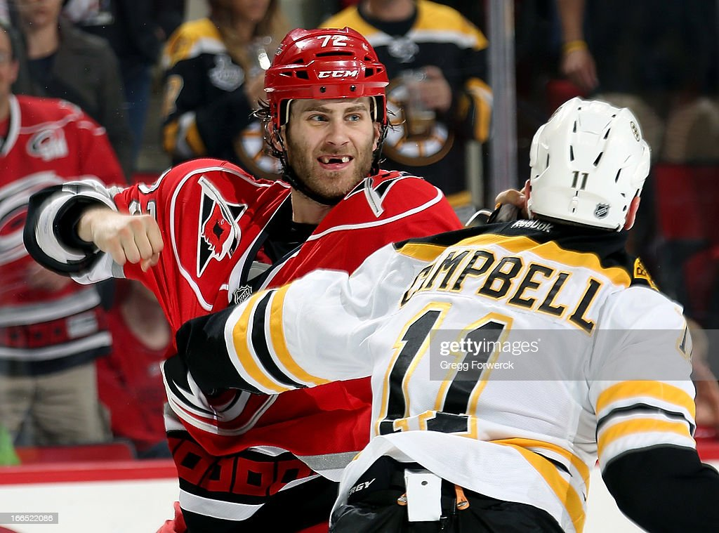 Nicolas Blanchard #72 of the Carolina Hurricanes exchanges punches with Gergory Campbell #11 of the Boston Bruins during their NHL game at PNC Arena on April 13, 2013 in Raleigh, North Carolina. Blanchard is playing his first NHL game in Raleigh after being recalled from Charlotte Checkers of the American Hockey League (AHL) on Thursday, April 11, when he made his NHL debut against the Washington Capitals.