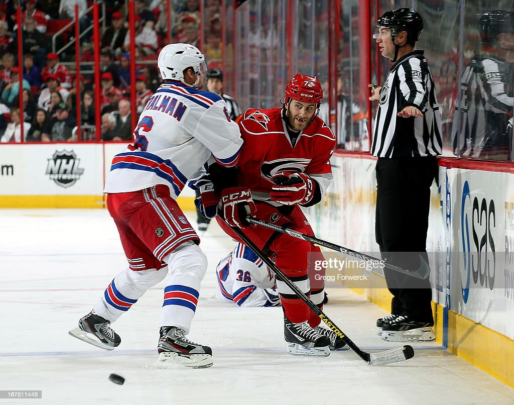 Nicolas Blanchard #72 of the Carolina Hurricanes passes the puck and prepares for a hit from Anton Stralman #6 of the New York Rangers during their NHL game at PNC Arena on April 25, 2013 in Raleigh, North Carolina.