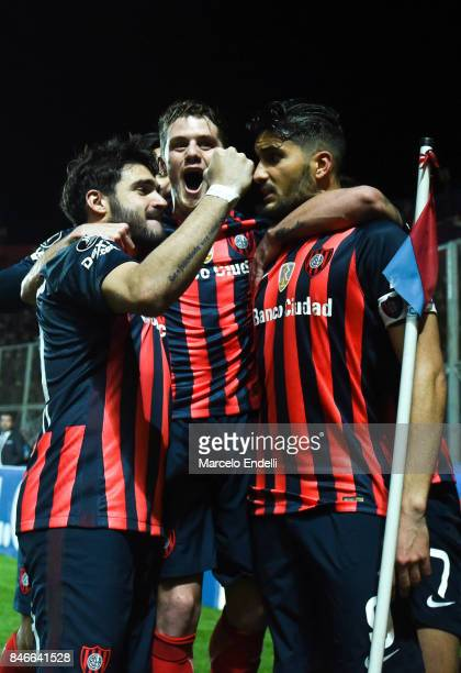 Nicolas Blandi of San Lorenzo celebrates with Bautista Merlini and Ezequiel Cerutti after scoring the second goal of his team with Ezequiel Cerutti...