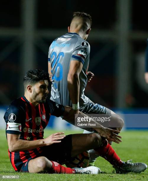 Nicolas Blandi of San Lorenzo fights for the ball with Marlon Mauricio Mejia of Emelec during a second leg match between San Lorenzo and Emelec as...