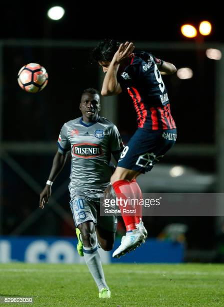Nicolas Blandi of San Lorenzo heads the ball during a second leg match between San Lorenzo and Emelec as part of round of 16 of Copa CONMEBOL...