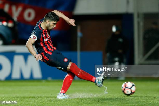 Nicolas Blandi of San Lorenzo takes a penalty during the penalty shootout after a second leg match between San Lorenzo and Emelec as part of round of...