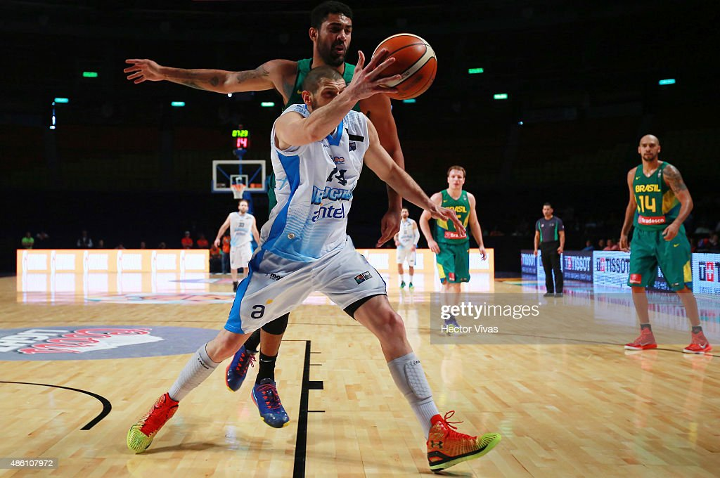 Nicolas Borsellino of Uruguay handles the ball against Augusto Lima of Brazil during a match between Uruguay and Brazil as part of the 2015 FIBA Americas Championship for Men at Palacio de los Deportes on August 31, 2015 in Mexico City, Mexico.
