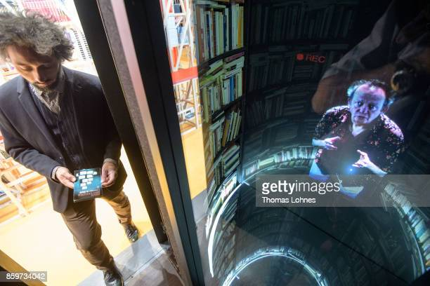Nicolas Boudier looks to the multimediainstallation 'LIR' with the hologram of the Adolfo Bioycasares in the French host country exhibition of the...