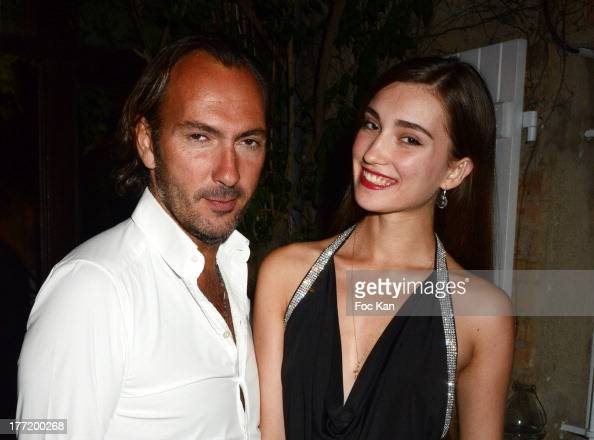 Nicolas Brochet and Anastasia Sycheva attend the Massimo Gargia's Birthday Dinner at Moulins de Ramatuelle on August 21 2013 in Saint Tropez France