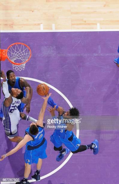 Nicolas Brussino and Nerlens Noel of the Dallas Mavericks rebound against the Sacramento Kings on April 4 2017 at Golden 1 Center in Sacramento...