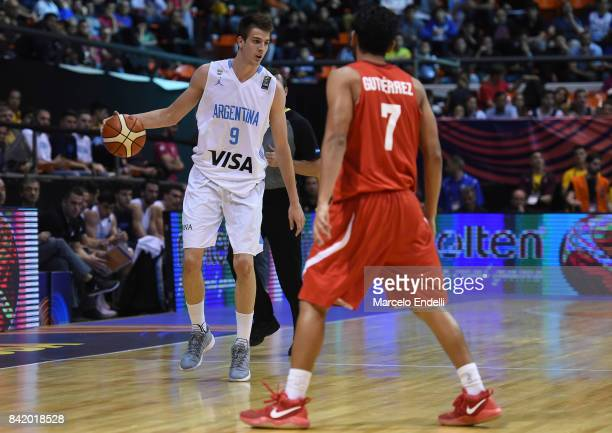 Nicolas Brussino of Argentina drives the ball against Jorge Gutierrez of Mexico during a semi final match between Argentina and Mexico as part of...