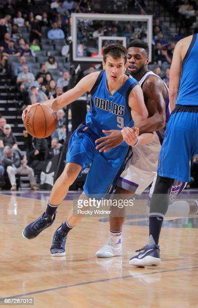 Nicolas Brussino of the Dallas Mavericks drives against Buddy Hield of the Sacramento Kings on April 4 2017 at Golden 1 Center in Sacramento...