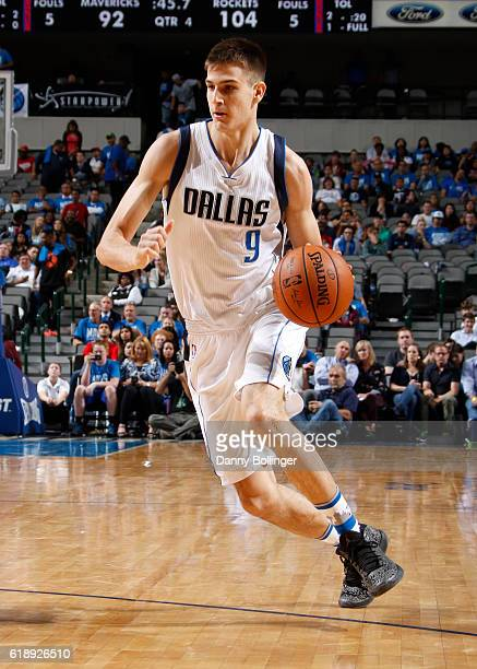 Nicolas Brussino of the Dallas Mavericks drives to the basket against the Houston Rockets on October 28 2016 at the American Airlines Center in...